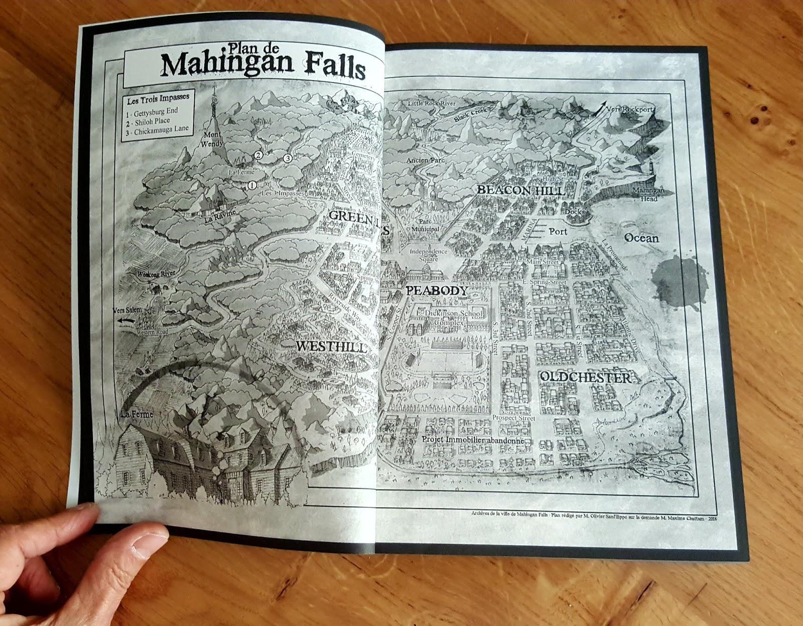Le roman Le Signal ouvert sur la page du plan de la ville de Mahingan Falls.